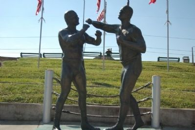 The statue was dedicated in 1988 and depicts the first world championship fight.