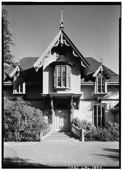 A black and white photo of the House.