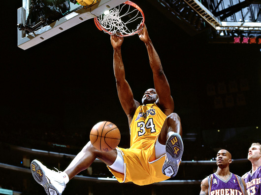 Shaquille O'Neal preforming one of his signature two handed slams.