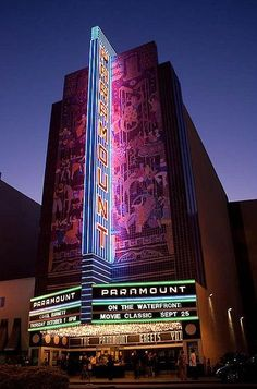 The Paramount's neon sign lit up at night time.
