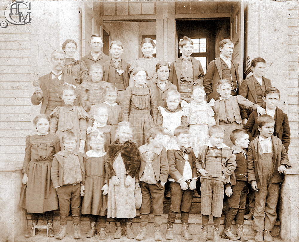 Students and teacher of the first Tyler school at Christmas time 1899.