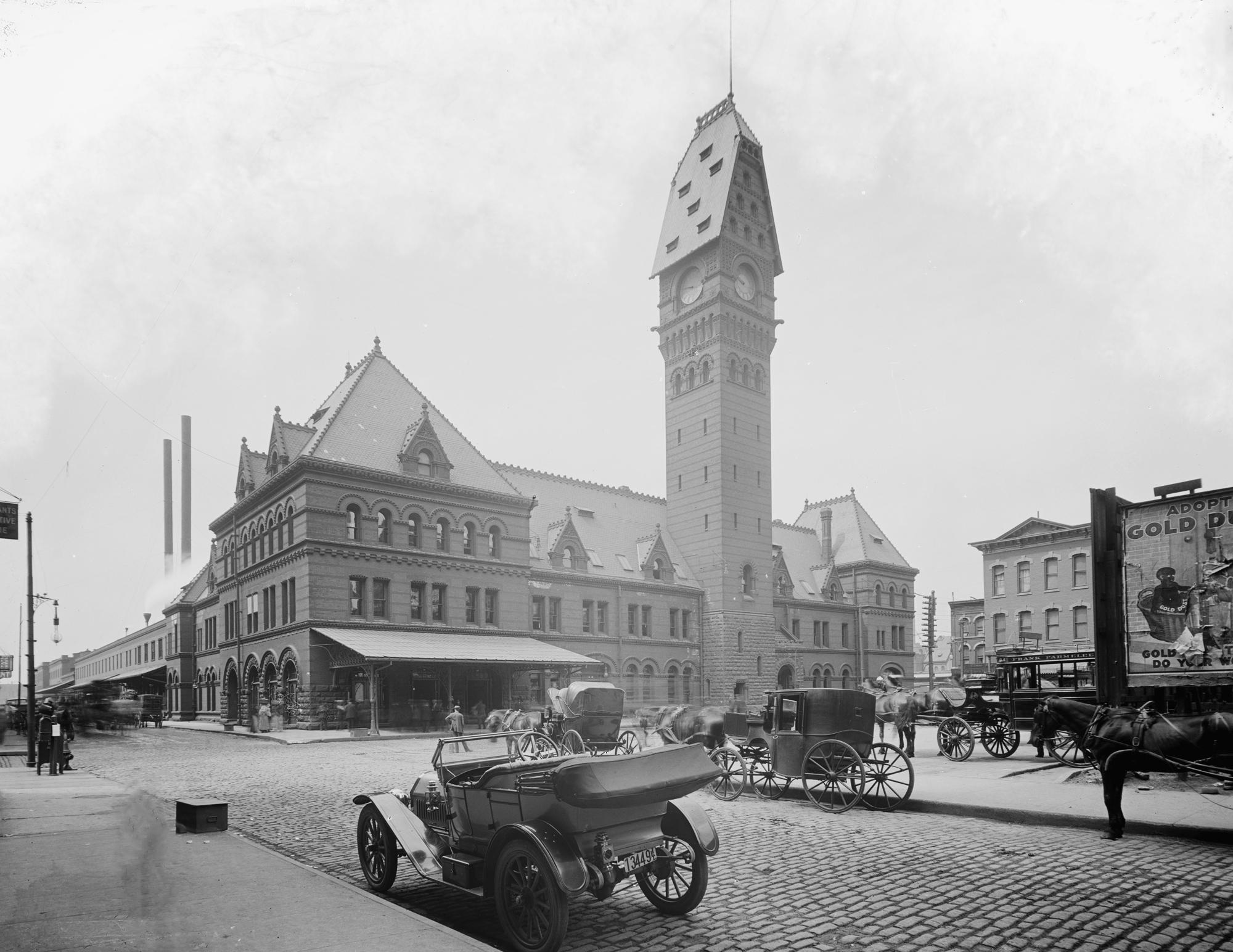 In 1922, a fire damaged the clock tower. This picture notes the pitched roof that existed prior to that fire. Photo provided by American-railway.com, but owned by Detroit Publishing Company.