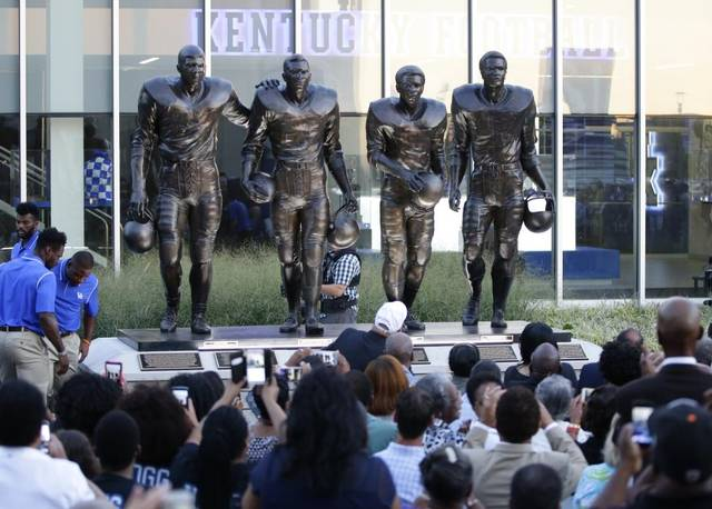 The statue depicts Nate Northington, Greg Page, Wilbur Hackett, and Houston Hogg, the first African American players in the SEC.
