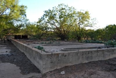 The remains of a building's foundation at the former camp.