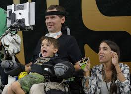 Steve Gleason wheelchair bound with wife and son