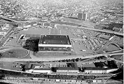 This historic photo of the arena shows a very different view of downtown Portland prior to the construction of numerous downtown buildings and the Moda Center.