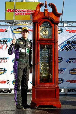 Denny Hamlin with his iconic Grandfather Clock trophy