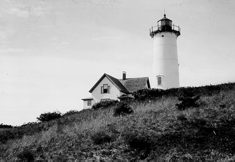 Nauset Light in Eastham, MA 1923, soon after its relocation from Chatham.  The light was not painted with its iconic red and white daymark until the early 1940s.