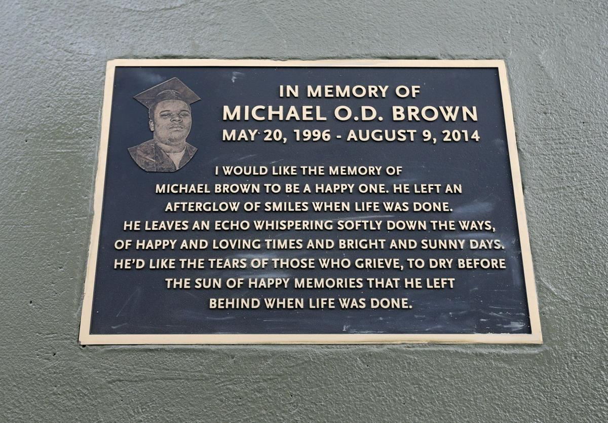 In this photo is the plaque that lies on the sidewalks of Canfield Drive in Ferguson, Missouri. It was written by his family members with the hope that readers understand Michael's importance in life, rather than his importance in death.