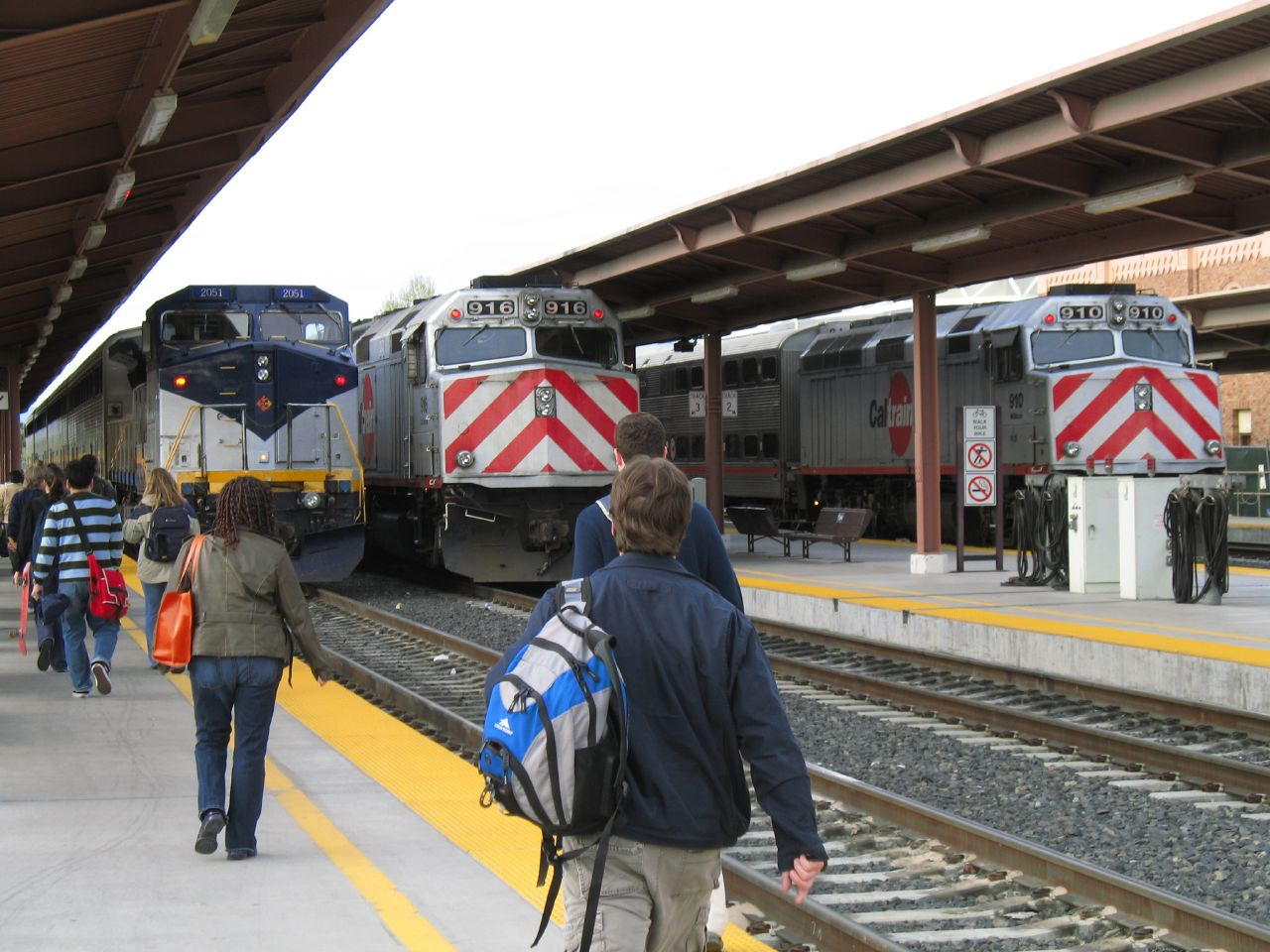 Passengers head toward the trains on one of Diridon Station's multiple platforms.