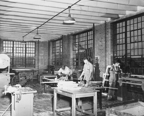This image depicts young men at the facility in the shop at around mid-century.