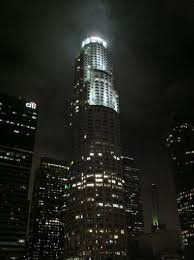 A shot of the tower lit up at night time.