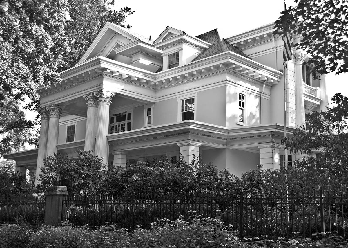 A side view of the Parker-Fersen mansion. This view emphasizes the home's grandeur. With a multitude of columns and balconies, 1409 E Prospect Street remains one of Seattle's oldest and finest residences to date.