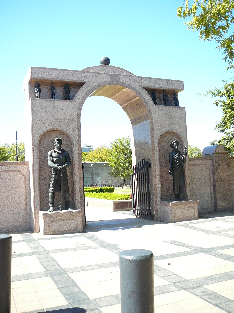 Arched granite entrance into the cemetery.