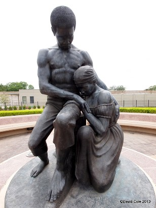 One of the many sculptures at the memorial cemetery depicting the families who were buried here in the aftermath of slavery