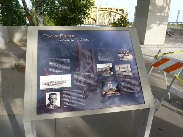 Historical information greets pedestrians as they cross the Tower Bridge.