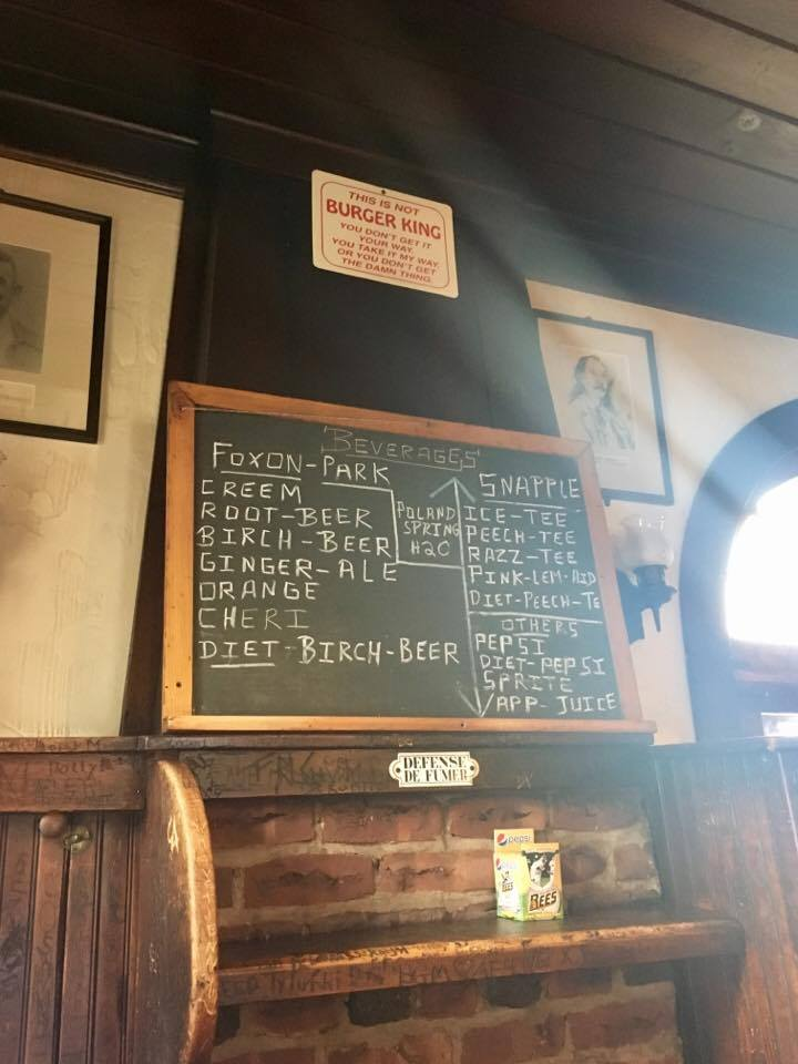 Signs inside Louis' attest to its local roots and unique personality