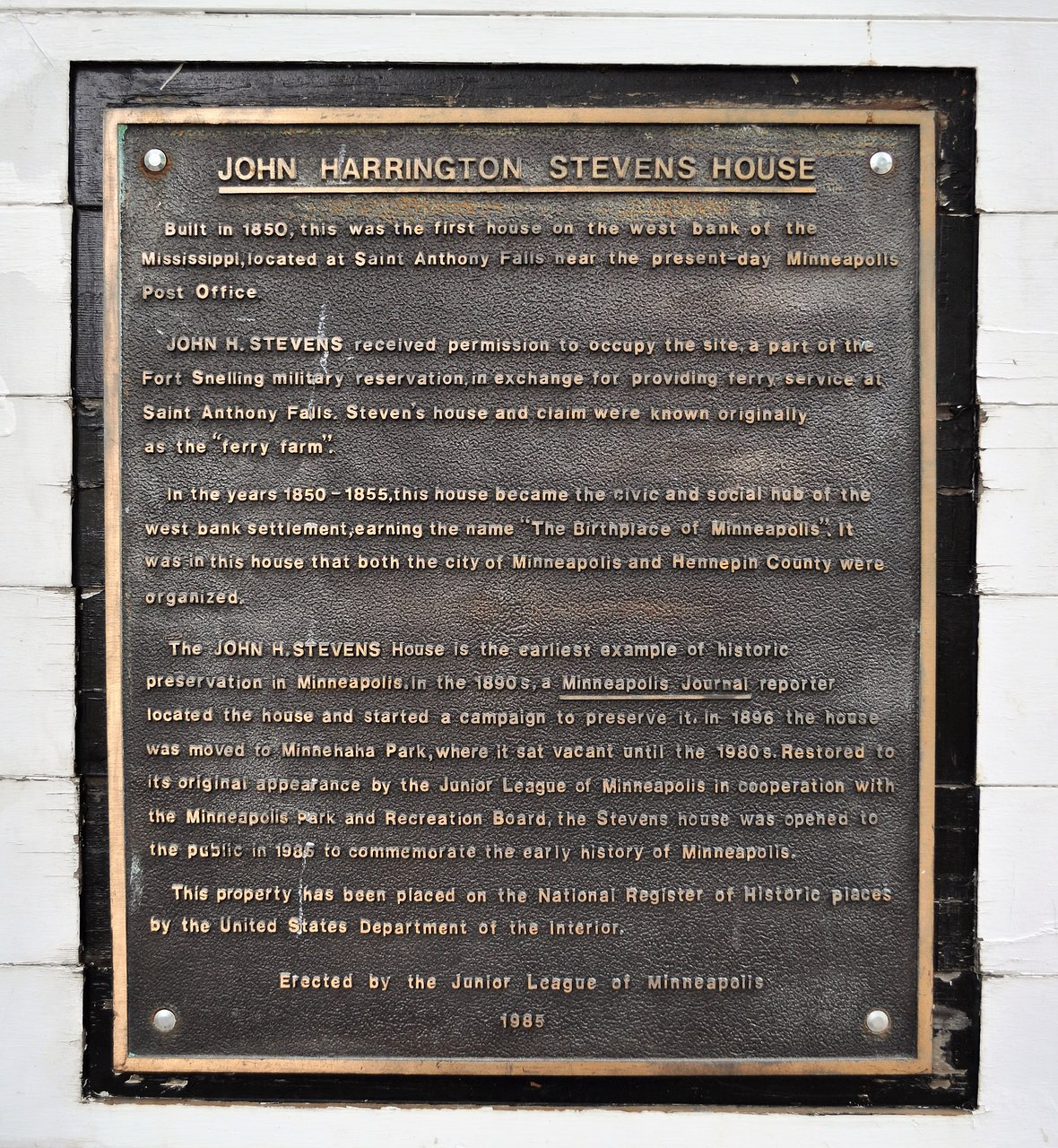 A plaque detailing the history of the house and its preservation