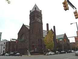 This historic downtown church features the American Romanesque Revival architectural style