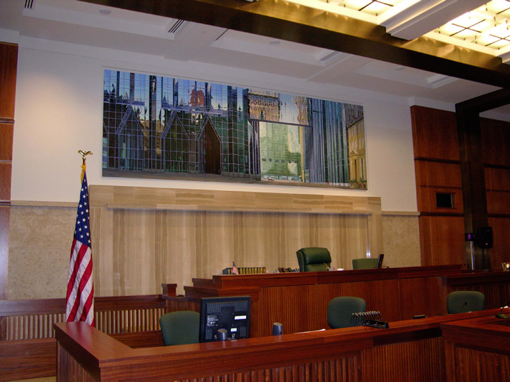 One of the courtrooms with a Brian Shure mural behind the bench.