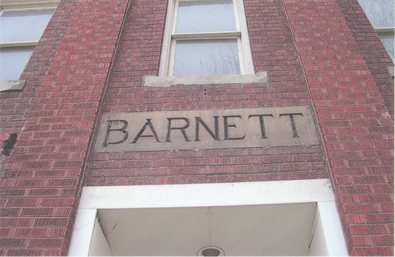 "The ""Barnett"" inscribed over the former hospital's entry is still visible today"