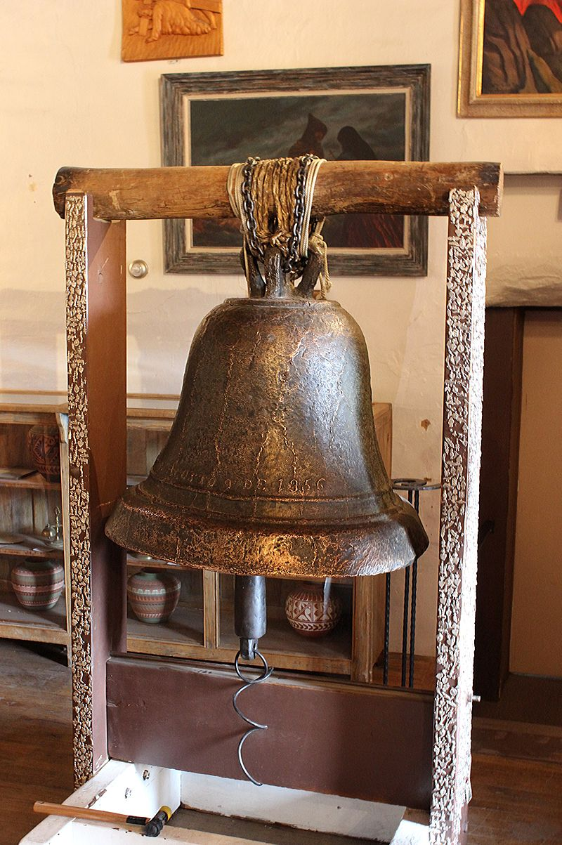 "Original thick-walled church bell within San Miguel Mission at Santa Fe, New Mexico with the inscription ""San Jose Rogad Por Nosotros Agosto 9 de 1356/1856"" in English, the bell reads ""St. Joseph Pray for us August 9th, 1356/1856"". It is thought that"