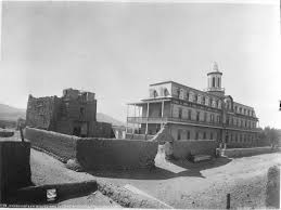 Circa 1881 photo of San Miguel Mission (left) and St. Michael's Dormitory. This photo gives a great idea of what the dorm looked like as originally constructed. Photo by W.H. Jackson and Co. Courtesy of the Palace of the Governors photo archives