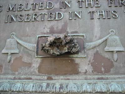 Close up of he plaque with a piece of the original melted bell