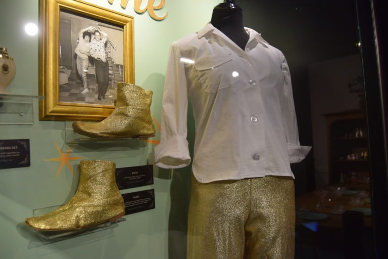 Matching gold lamé pants and boots: one of Cline's stage costumes