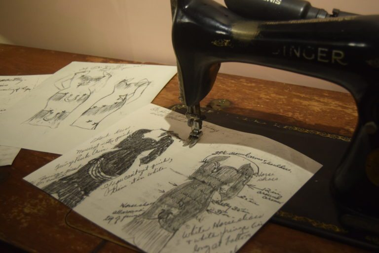 Cline's mother's sewing machine and dress patterns drawn by Cline herself