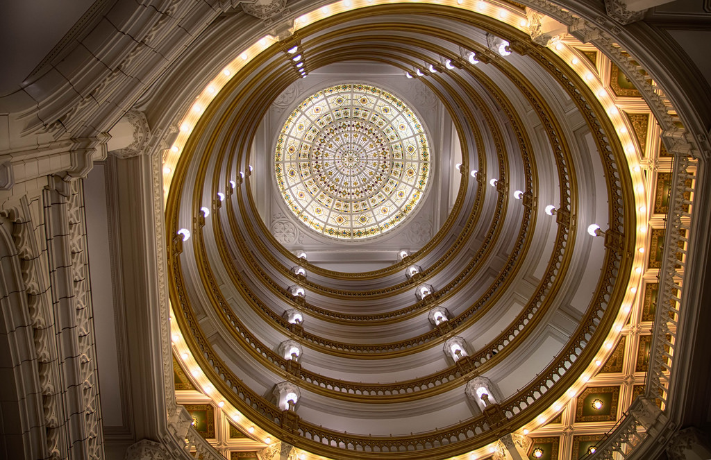 A vertical view of the building's central, 150-foot rotunda with stained-glass cap.