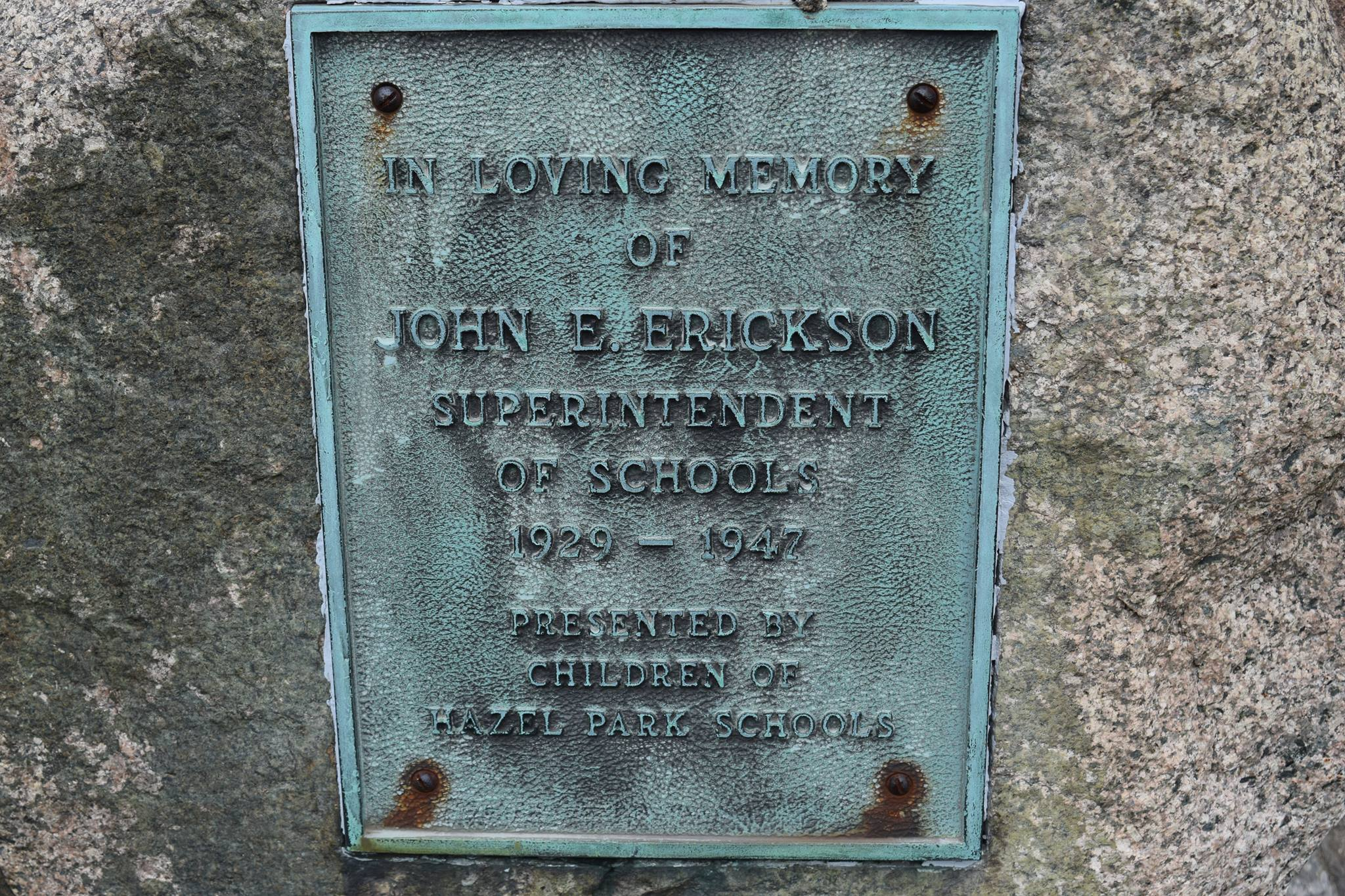 Plaque in front of the Hazel Park Historical Museum, dedicating what was the Hazel Park Library in honor of John E. Erickson, who spearheaded the creation of a public Library in Hazel Park, Michigan.