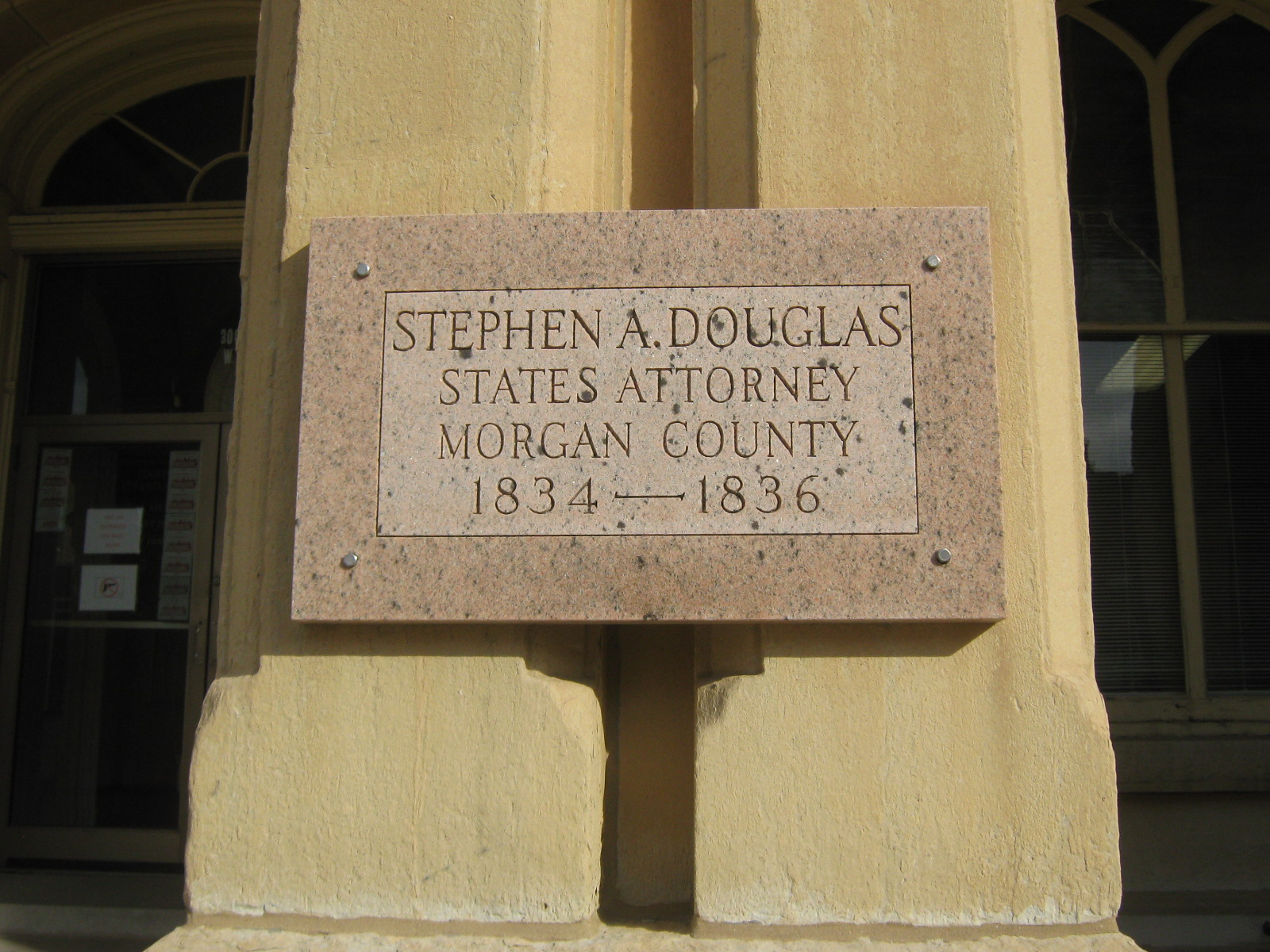Stone plaque on the front of the Morgan County Courthouse.
