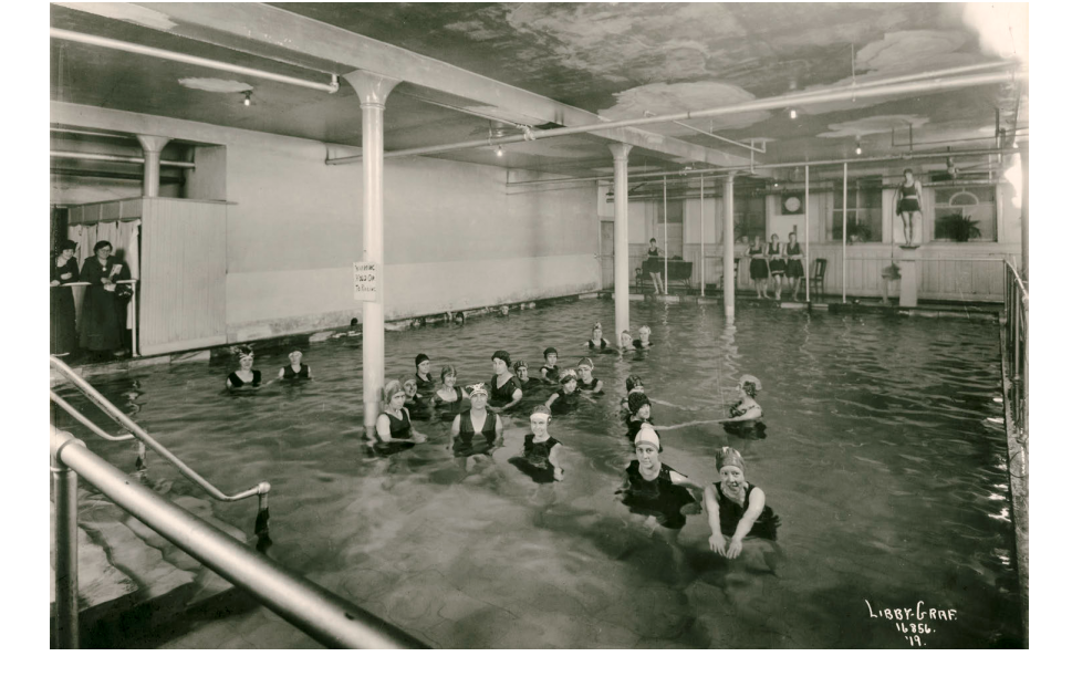 1919: Women in swimming pool (likely YWCA meeting) at original four-story Ridpath Hotel.