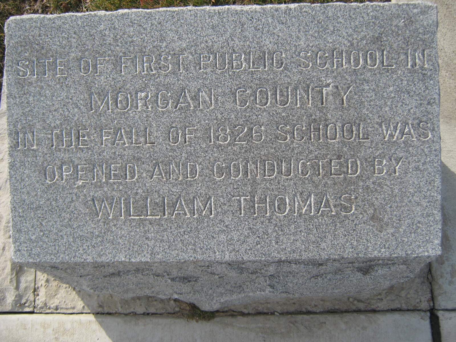 Located on East Collage, near the church sign.
