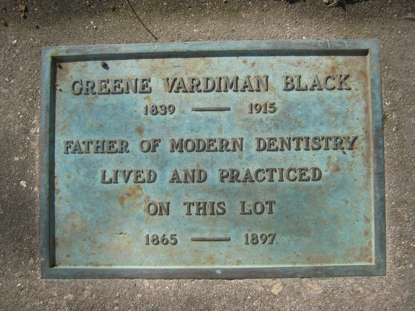 This plaque is located in the sidewalk, next to the state historical marker on East State St.