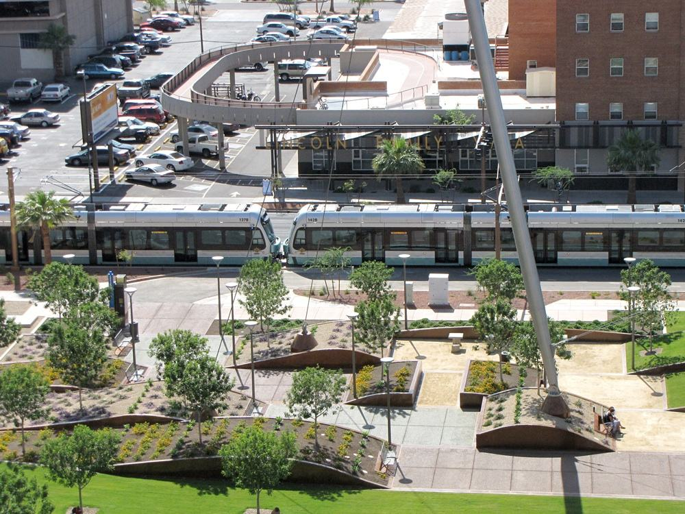 The park and sculpture are adjacent to the Light Rail. (aecom.com)