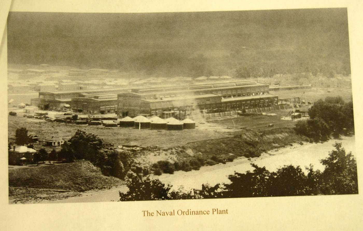 An early photo of the North Unit looking southwest, which produced gun forgings and projectiles. At upper left, the original workers' barracks are still visible, so the South Unit (not pictured) is still under construction.