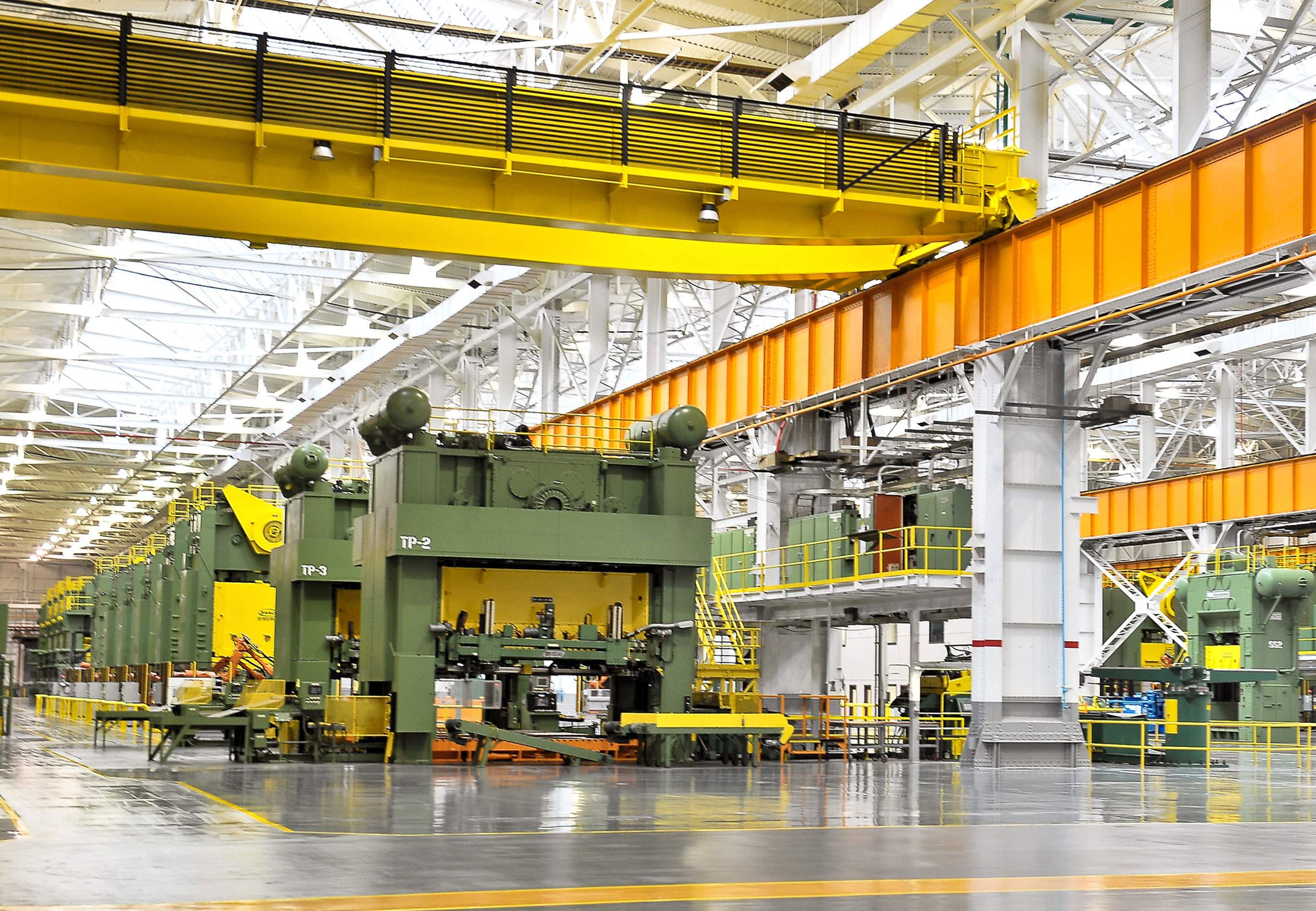 The modern-day auto parts stamping plant interior in a photo from 2012, shortly after Gestamp began leasing the original Machine Shop. The overhead crane, still in use, dates back to 1941, or may even be original to the NOP. Photo by Bob Wojcieszak.