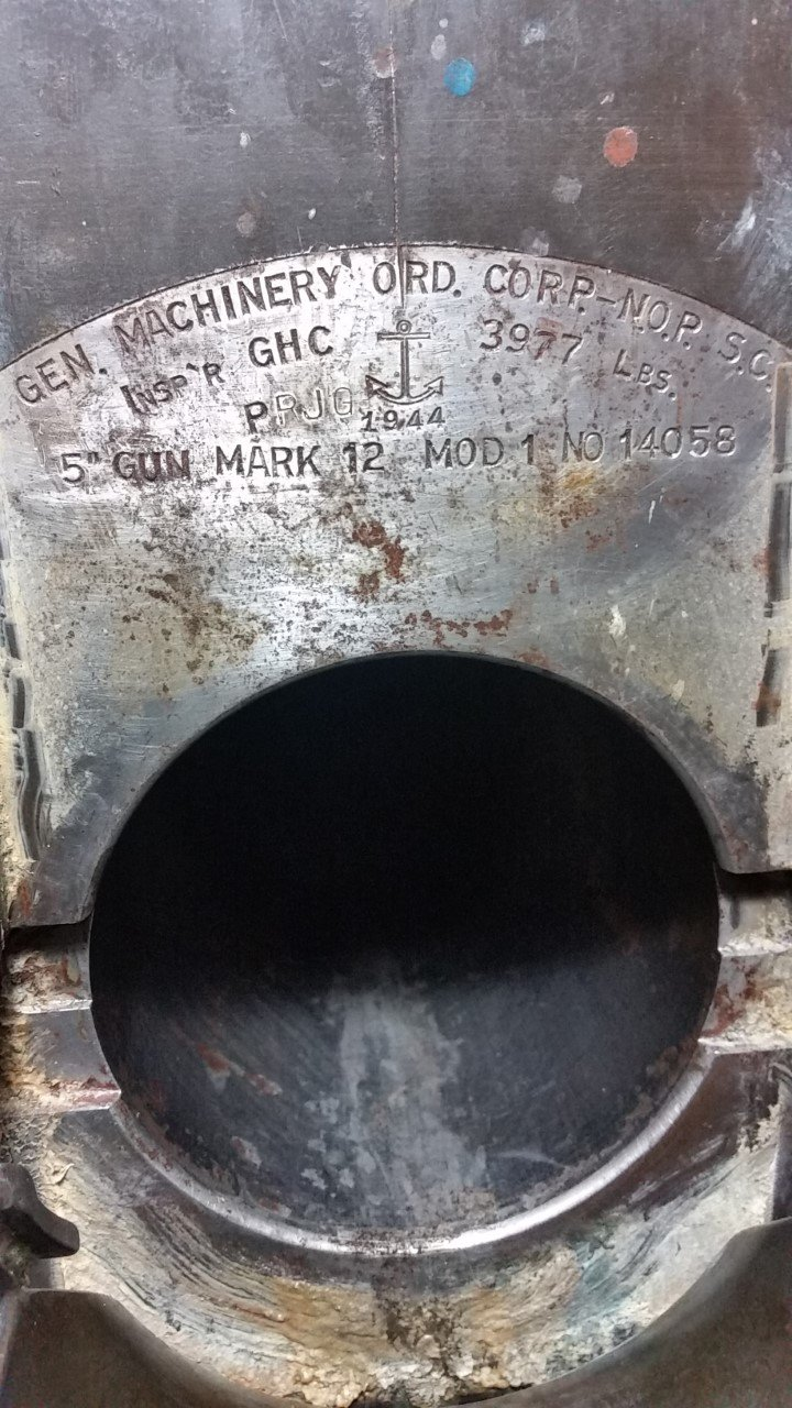 "The NOP foundry mark on a 5-inch, 38-caliber gun on the USS Iowa, ""Battleship of Presidents,"" which transported President Roosevelt to his meeting in Tunisia with Churchill and Stalin. Twenty 5"" guns comprised the Iowa-class's secondary battery."