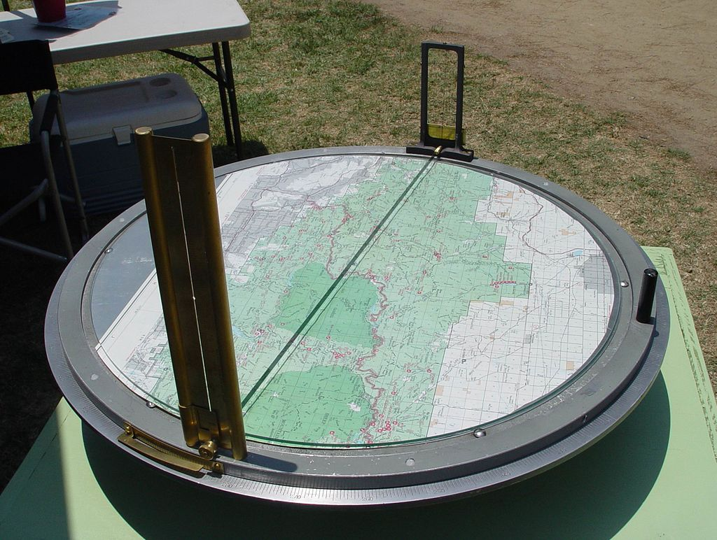 An Osborne Fire Finder alidade, used to calculate the coordinates of a fire. Photo courtesy of Charles White, https://commons.wikimedia.org/w/index.php?curid=45478559.