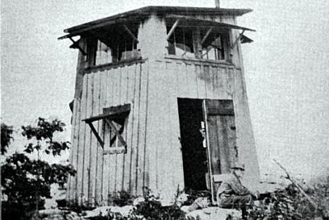 "A ""Jenny Lind"" style fire tower at Signal Knob in Pocahontas County.  A simple wooden structure, where the top floor was used for observation and the bottom for living quarters."