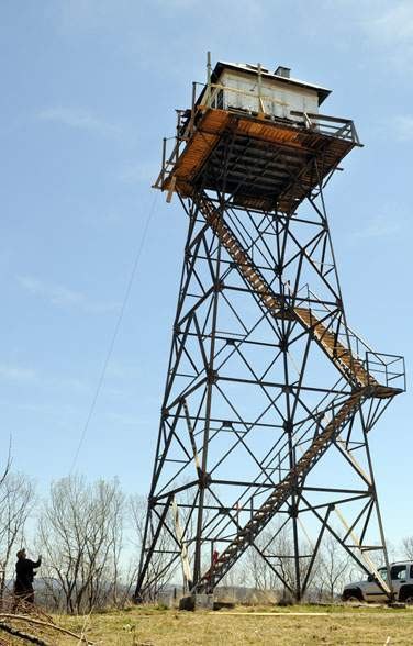 The refurbishing of Thorny Mountain.  Materials were hauled up to the cab by rope and pulley, as supplies would have been during the days of the tower's operation.   Photo by Chris Dorst.