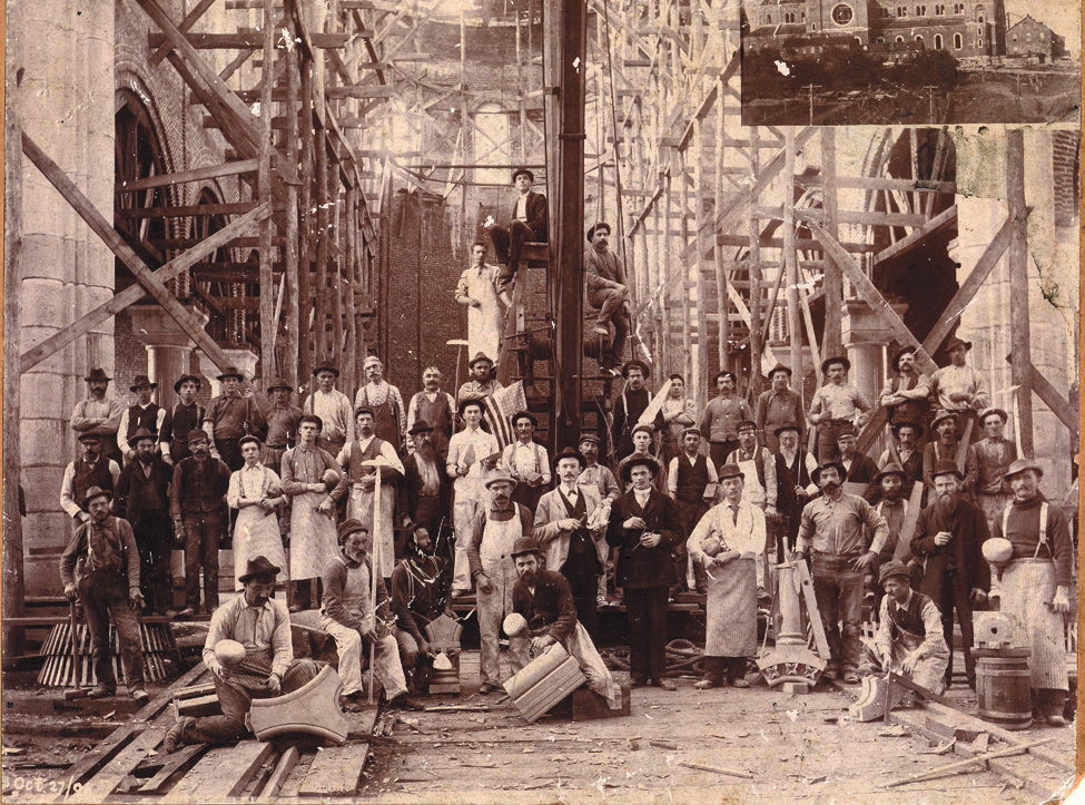 "The ""Basilica Builders"" pictured in October 1896, holding the tool of their trade."