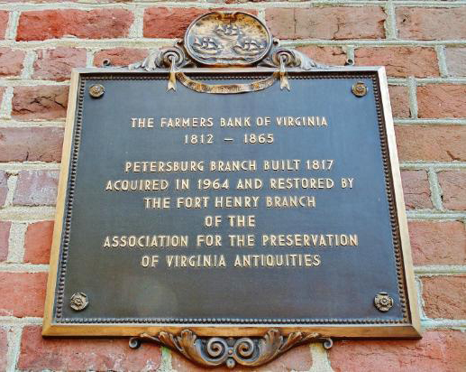 Plaque commemorating the history and preservation of Historic Farmers Bank.