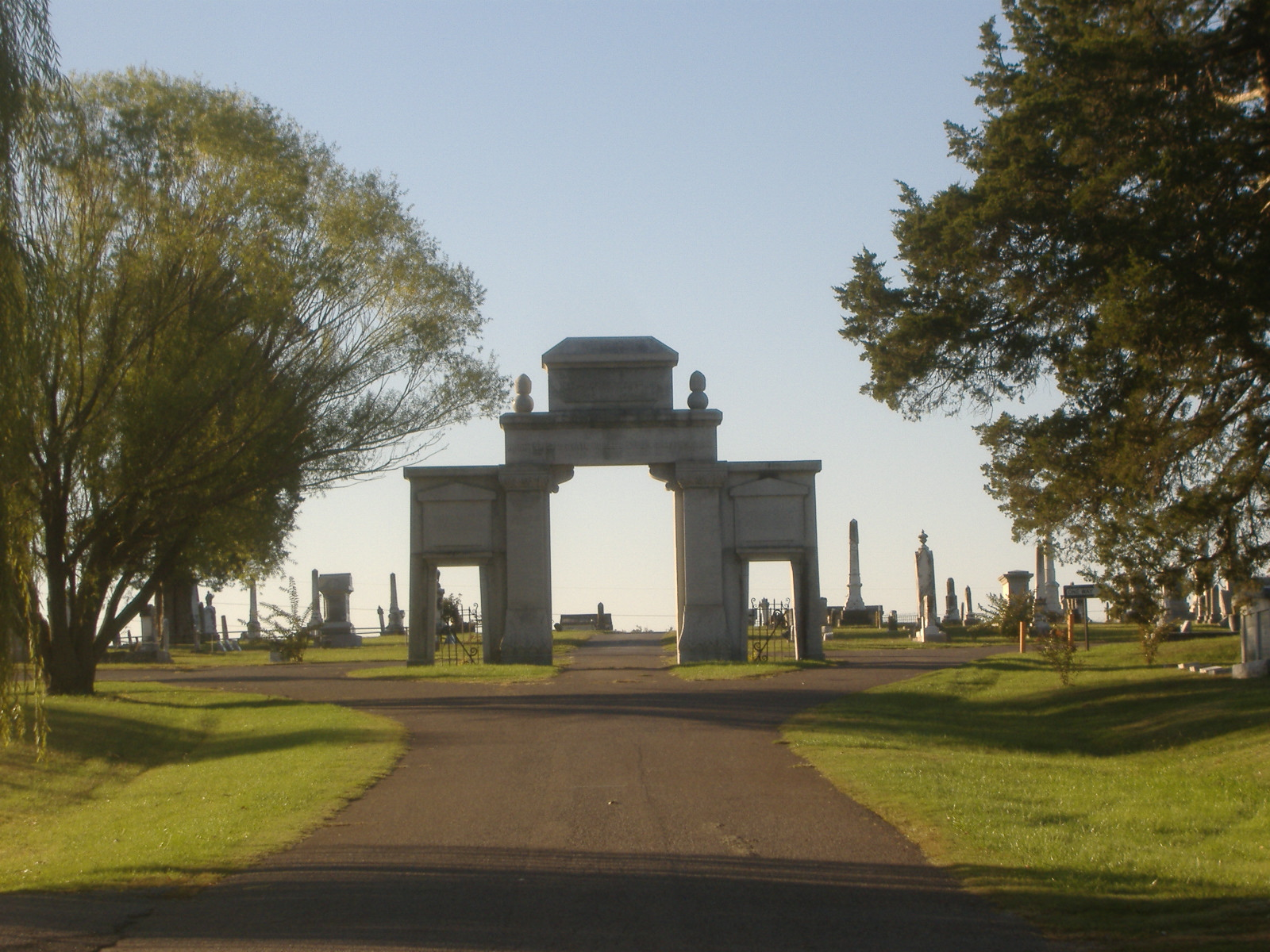 The gateway is located near the entrance to cemetery
