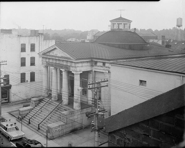Photo of the Exchange Building serving as the police station in 1959. Photo by HABS.