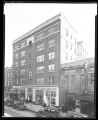 Shown is 608 W Walnut St (now Muhammad Ali Blvd), Louisville, Kentucky. The building in the center is the Mammoth Life and Accident Insurance Company (also owned by William H. Wright) with the American Mutual Savings Bank to the right.