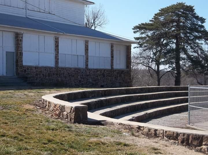 WPA-built former park pavilion (now skating rink) in background and rock seating for swimming pool in Municipal Park.