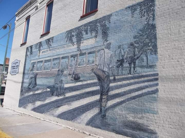 Scene above re-created as a mural on the west side of building at 140 West Third Street. Artist was John Biggs who also did murals on Burlingame and Chaffee Opera House and Pollard Building #1 (See Clio entries for both).